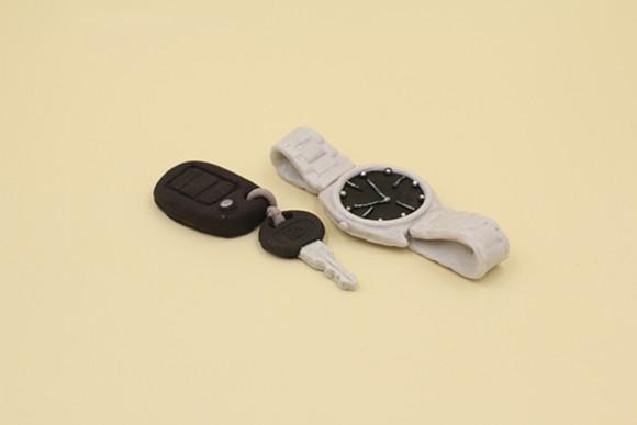 Годинник, срібний ключ та брелок